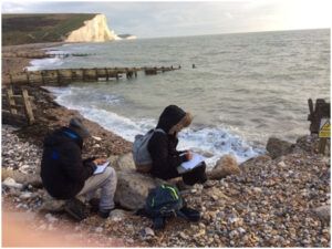 Students sketch landscape features in Cuckmere Haven